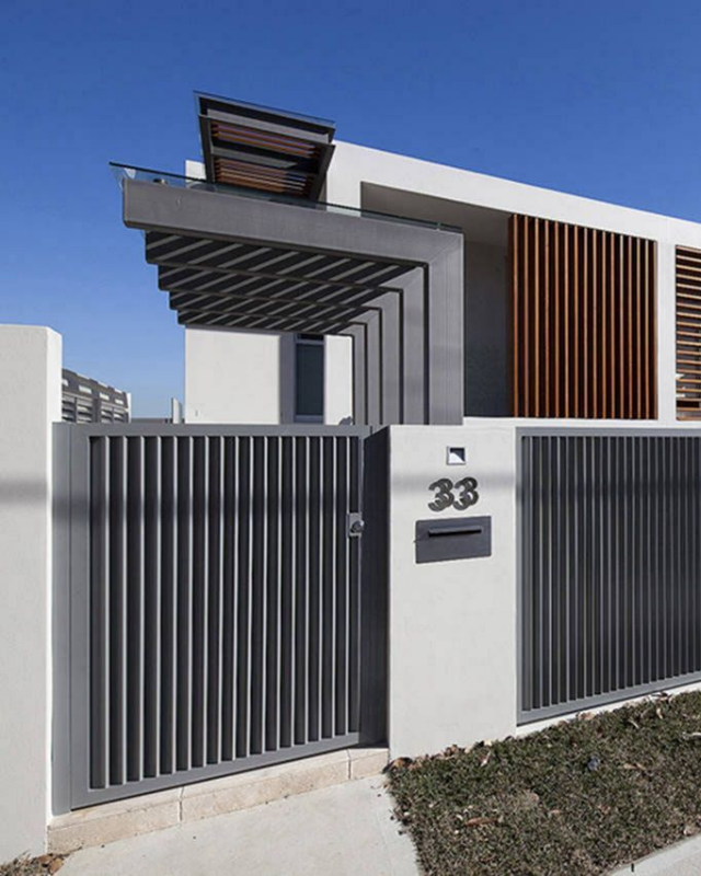 A secure house with a fence and sliding gate produced using steel.